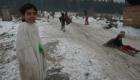 Zimní radovánky v cikánské osadě